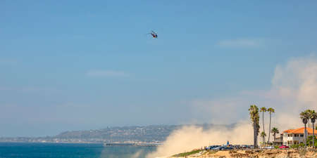 Helicopter in flight over the coast of La Jolla CA