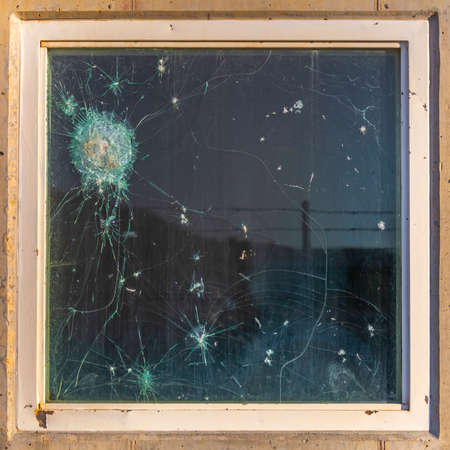 Bulletproof glass with gun shots and break Stock Photo