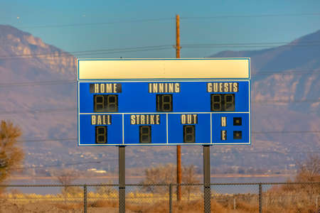 Close up of scoreboard and mountains behind