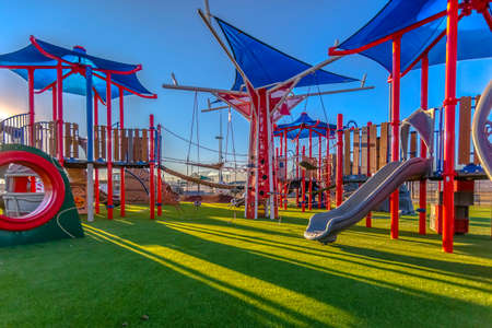 Sun light cast on playground red and blue colors