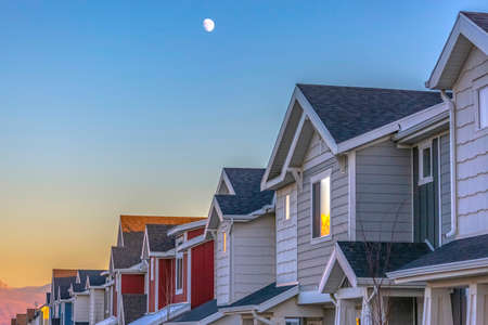Moon above Townhomes at sunset in Utah Valley