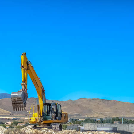 Excavator on a development site in Eagle Mountain Stock fotó