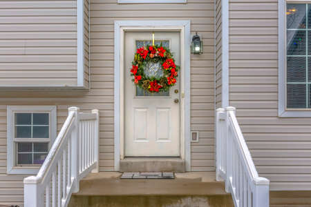 Stairs leading to front door with christmas wreath