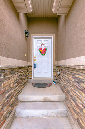 Steps on a narrow entryway leading to front door