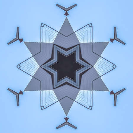Abstract star shape made from real estate photo. Geometric kaleidoscope pattern on mirrored axis of symmetry reflection. Colorful shapes as a wallpaper for advertising background or backdrop.