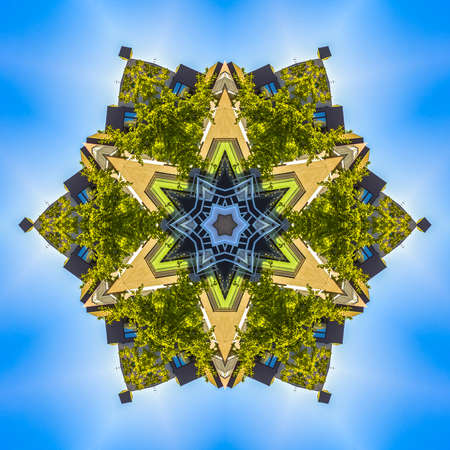 Hexagon star from buildings and foliage with points. Geometric kaleidoscope pattern on mirrored axis of symmetry reflection. Colorful shapes as a wallpaper for advertising background or backdrop.