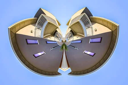 Dual radial bend of an apartment building. Geometric kaleidoscope pattern on mirrored axis of symmetry reflection. Colorful shapes as a wallpaper for advertising background or backdrop. 版權商用圖片