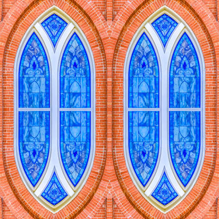 Reflection of stainless steel windows on church. Geometric kaleidoscope pattern on mirrored axis of symmetry reflection. Colorful shapes as a wallpaper for advertising background or backdrop.