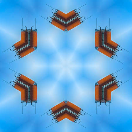 Minimal metal shapes make a symmetrical design. Geometric kaleidoscope pattern on mirrored axis of symmetry reflection. Colorful shapes as a wallpaper for advertising background or backdrop.