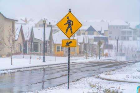 Pedestrian Crossing sign on an icy road in Utah