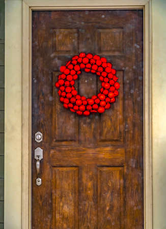 Vibrant bauble wreath on the front door of a home Stock Photo