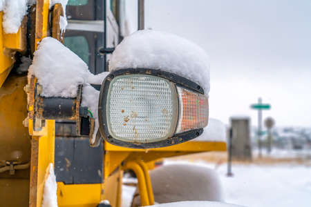 Snowy headlight of a construction vehicle in Utah