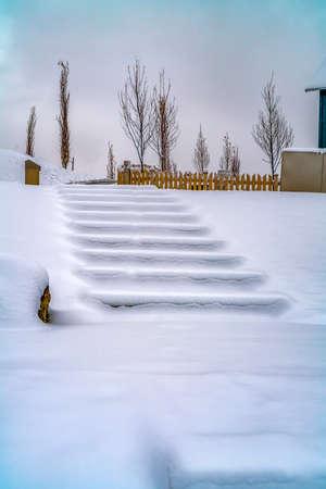 Steps on snowy landscape in Daybreak Utah Banco de Imagens - 118500849