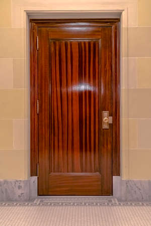 Glossy door inside Utah State Capital Building. Close up of a glossy brown wooden door inside Utah State Capital Building. View of stunning architecture inside the famous building of Salt Lake City. 스톡 콘텐츠