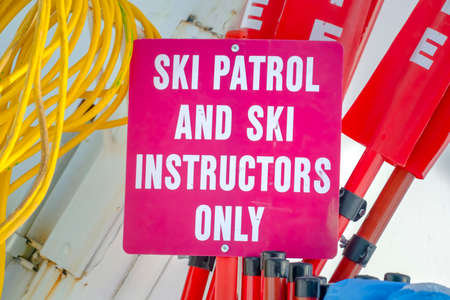 Ski Patrol and Ski Instructors Only sign in Utah. Close up of a signage on a sunny winter day in Park City, Utah.