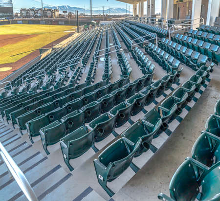 Tiered seating and viewing rooms on a baseball field viewed on a sunny day