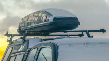 Panorama Black vehicle with a roof rack and rooftop cargo carrier viewed in winter Imagens