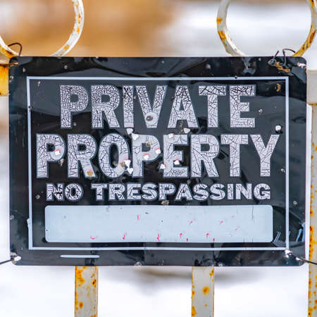 Square Close up view of a weathered sign that reads Private Property No Trespassing