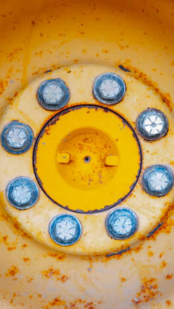 Vertical Close up view of the rusty wheel of a heavy duty construction machinery