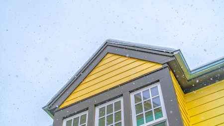 Clear Panorama Exterior of a home in Daybreak Utah with cloudy sky background in winter