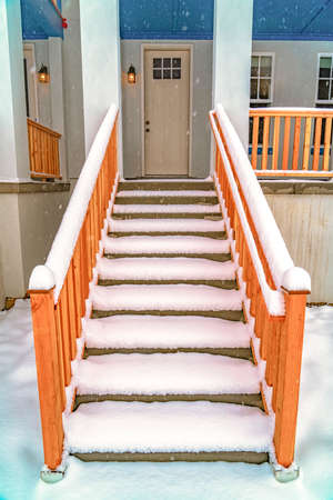 Stairs leading to the front porch and door of a home in Daybreak Utah. Fresh powdery white snow covers the entrance of this house in winter. Stok Fotoğraf