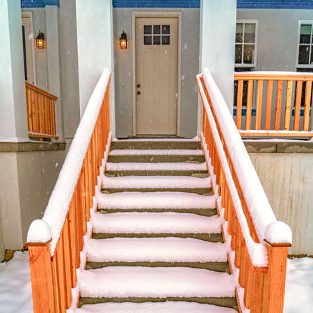 Clear Square Stairs leading to the front porch and door of a home in Daybreak Utah. Fresh powdery white snow covers the entrance of this house in winter. Stok Fotoğraf