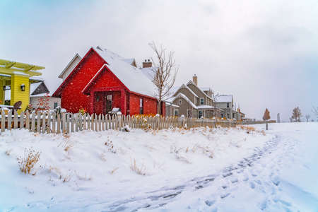 Footprints on powdery snow along the charming homes at winter time in Utah