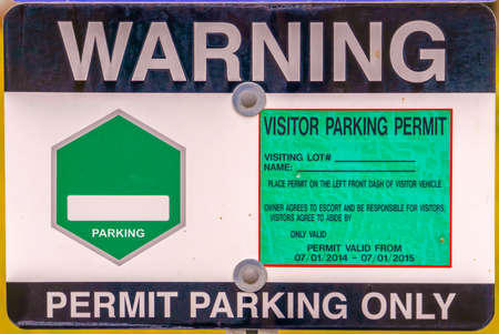 Close up view of a Warning Permit Parking Only sign board