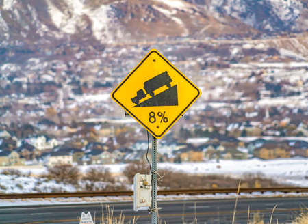 Close up of a yellow road grade sign with a truck on slope illustration Reklamní fotografie