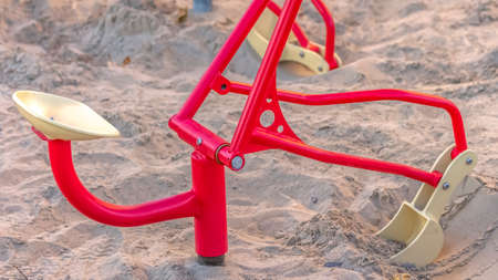 Panorama frame Close up of construction sand digger toys for children at a playground