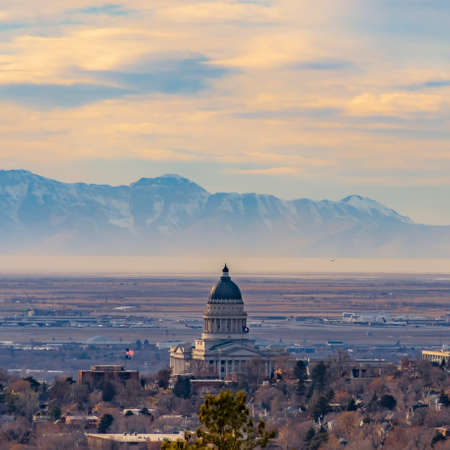 Square frame Panorama of downtown Salt Lake City against majestic mountain and cloudy sky