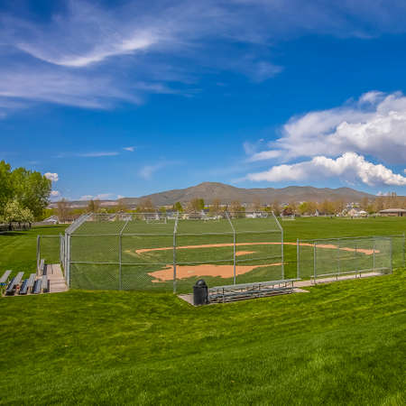 Square Baseball or Softball field with bleachers outside the safety fence