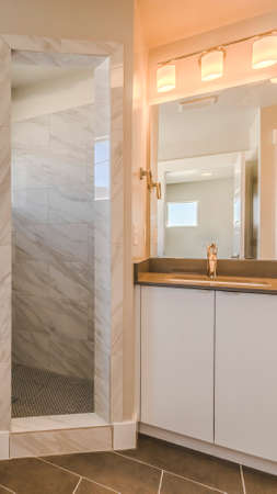 Panorama Bathroom interior with bathtub glass door shower and vanity area