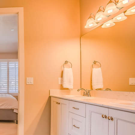 Square frame Bathroom interior with built in bathtub shower stall and vanity area