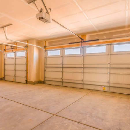 Square Interior of an unfinished garage with unpainted walls and ceiling Stock Photo