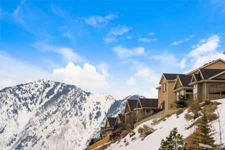 Houses built on top of a mountain blanketed with snow in winter