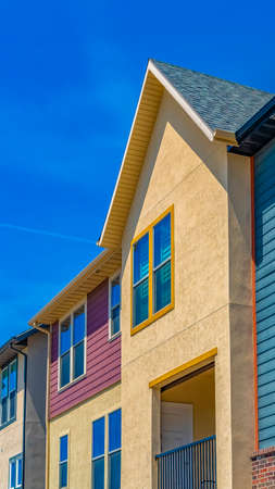 Vertical Exterior view of houses with balcony and multi colored wall