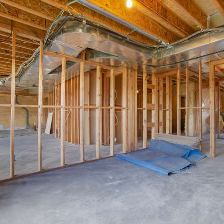 Square House interior under construction with air conditioning ducts on the ceiling Stock Photo - 124950239