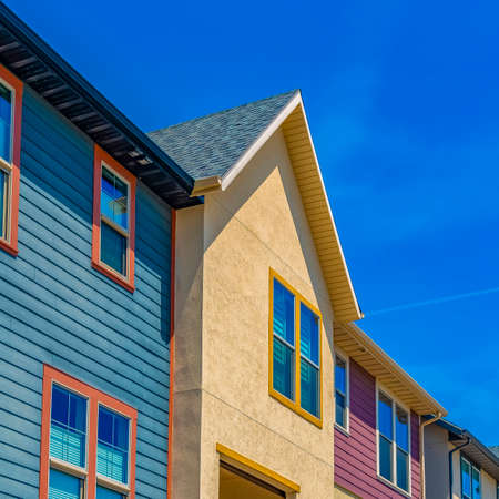 Square Exterior view of houses with balcony and multi colored wall Stock Photo