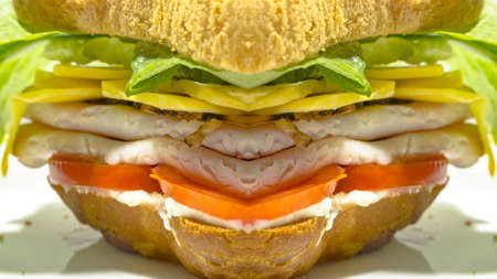 Reflected turkey sandwich with meat and lettuce. Geometric kaleidoscope pattern on mirrored axis of symmetry reflection. Colorful shapes as a wallpaper for advertising background or backdrop. 写真素材