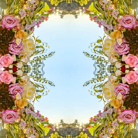 Symmetrical pink roses and green leaves made into an abstract shape at sunset for a California wedding. Geometric kaleidoscope pattern on mirrored axis of symmetry reflection. Colorful shapes as a wallpaper for advertising background or backdrop. 스톡 콘텐츠