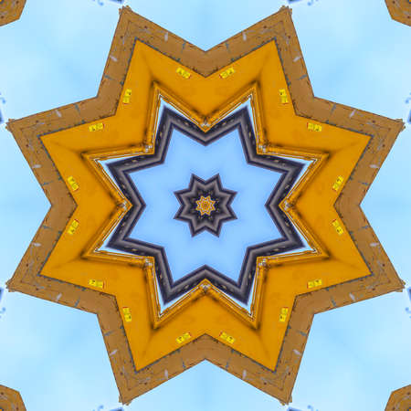 A pointed star shape made from a yellow tractor. Geometric kaleidoscope pattern on mirrored axis of symmetry reflection. Colorful shapes as a wallpaper for advertising background or backdrop.