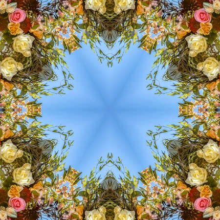 Circular and angular floral design with colorful flowers from a wedding. Geometric kaleidoscope pattern on mirrored axis of symmetry reflection. Colorful shapes as a wallpaper for advertising background or backdrop.