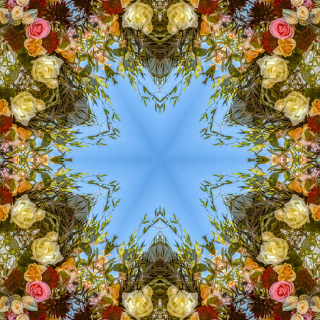 Floral design with interesting angles and colorful flowers. Geometric kaleidoscope pattern on mirrored axis of symmetry reflection. Colorful shapes as a wallpaper for advertising background or backdrop.