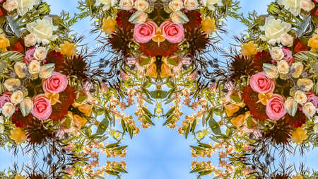 Panorama Busy floral design in a circular pattern with roses and other flowers