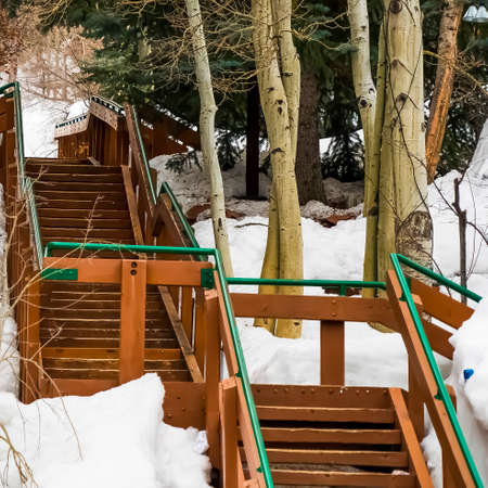 Square frame Outdoor stairs on a mountain slope covered with snow during winter Фото со стока