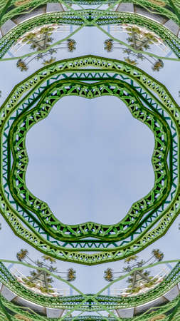 Vertical Circular green metal bars created using reflections in a rounded shape from a bridge in California with copy space