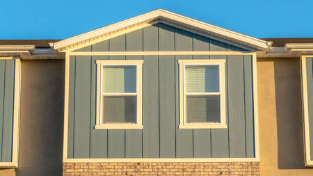 Panorama frame Close up view of sunlit townhouse exterior with clear blue sky background Stok Fotoğraf