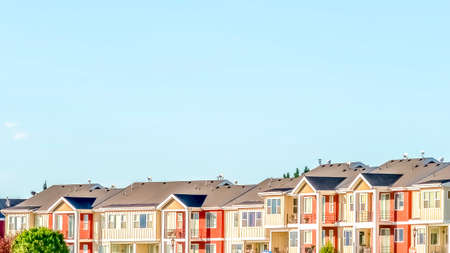 Panorama frame Blue sky on a sunny day over townhomes with white and red exterior wall
