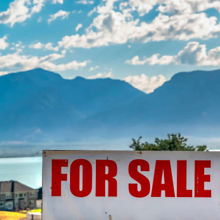 Square frame For Sale real estate sign with lake mountain and cloudy blue sky background Banco de Imagens